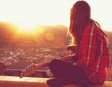 Sad-alone-cute-girl-playing-guitar-sunset